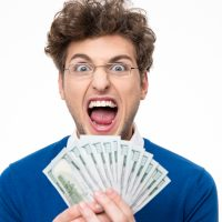 Man in glasses with money shouting over white backgorund